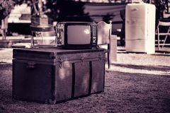 Old TV, chest in the street. Old TV, chest and various furniture on the street Royalty Free Stock Photos