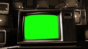 Old Tv With Green Screen With Many 80S Tvs. Sepia Tone. Dolly In.