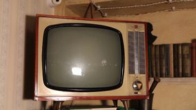Old TV, retro TV in an old interior. Authentic Static On Old Fashioned TV Screen. Old TV with green screen, retro TV in an old interior with a green screen stock video