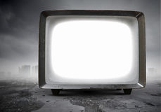 Old TV monitor. Mixed media. Grungy old TV set as concept for technologies development. Mixed media Royalty Free Stock Image