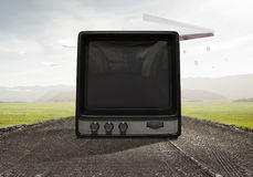 Old TV monitor. Mixed media. Grungy old TV set as concept for technologies development. Mixed media Stock Photos