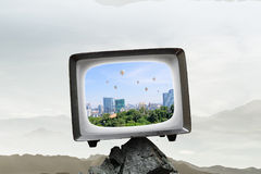 Old TV monitor. Mixed media. Grungy old TV set as concept for technologies development. Mixed media Royalty Free Stock Images