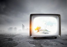 Old TV monitor. Mixed media. Grungy old TV set as concept for technologies development. Mixed media Stock Images