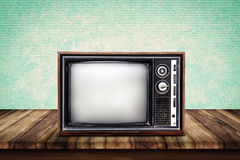 Old TV On Wood Table. Royalty Free Stock Photo