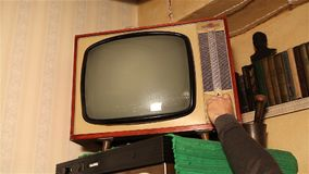 Old TV, retro TV in an old interior. Authentic static on old fashioned tv screen. Old TV with green screen, retro TV in an old interior with a green screen stock video footage