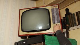 Old TV, retro TV in an old interior. Authentic static on old fashioned TV Screen. Old TV with green screen, retro TV in an old interior with a green screen stock footage
