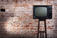 The old TV set. Against an old brick wall Royalty Free Stock Images