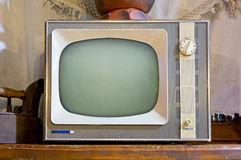 Old tv set. In vintage interior Royalty Free Stock Images