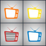 Old TV Sets with antennas. Yellow, red, orange and blue colors Royalty Free Stock Photo
