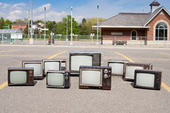 Old TV sets at railway station stock photos