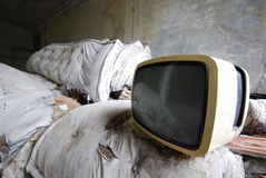 Old TV - vintage - abandoned. Old TV with black and white screen.  Television concept - vintage tv Stock Photos