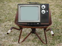 Old TV in a wheelbarrrow Royalty Free Stock Images
