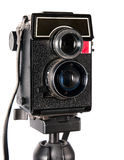 Old twin-lens camera. Old dusty twin lens photocamera on tripod stock photo