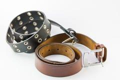 Old two leather belt roll. Old two leather belt roll on white background Stock Image