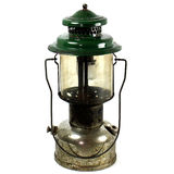 Old Two Mantel Kerosene Lantern Used For Camping. A studio shot of an old, rusty, green and silver color lantern isolated on white background Royalty Free Stock Photo