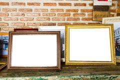 Old two photo frames on the wooden table. Royalty Free Stock Photography