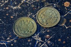 Old two silver coin on a blue background Royalty Free Stock Photo