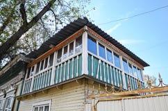 Old two-storey wooden house with dlazed attic. Irkutsk streets Royalty Free Stock Image