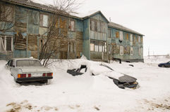 Old two-storied  blue house in winter with snow outdoor. Poverty and misery, North Stock Photography