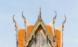 Old tympanum and orange tile roof. Of local Thai temple Royalty Free Stock Images