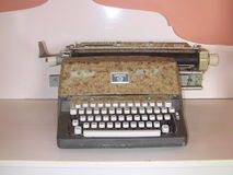 Old Type Writer. Antique Old Type Writer display in old light house. It has rusty look brand Hermes-9 Stock Photo