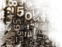 Old typeset numbers. Faded at the edges Royalty Free Stock Image