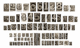 Old typeset numbers. Isolated old mettalic typeset numbers Stock Photo