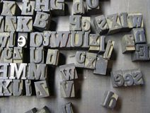 Old Typesetter letters. Old lead letters used for typeset printing Stock Image