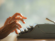 Old typewrite with fingers Royalty Free Stock Photography