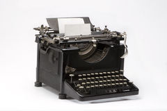 Old typewriter. Old typewriting machine on white background Stock Photo