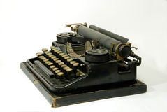 Old typewriter. A typewriter is a mechanical or electromechanical device with a set of keys that, when pressed, cause characters to be printed on a medium Royalty Free Stock Photos