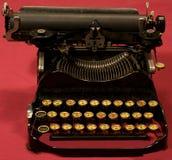 Old Typewriter. Old antique black typewriter with gold keys Royalty Free Stock Photo