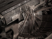 Old typewriter in action Royalty Free Stock Photography