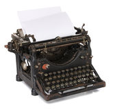 Old typewriter with a blank paper Royalty Free Stock Photo