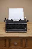 Old typewriter and blank paper. Royalty Free Stock Photos