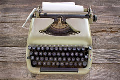 Old typewriter with blank paper Royalty Free Stock Images
