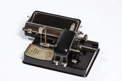 Old typewriter, blank sheet in a typewriter. Stock Photos
