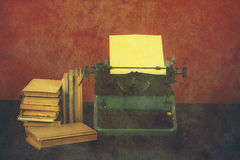 Old typewriter with books retro colors on the desk Stock Images