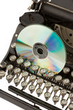 Old typewriter and CD Stock Photography