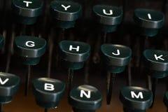 Old Typewriter Dusty Keys for Communication. Detail closeup of old typewriter keys with dust for writing communication Stock Photo