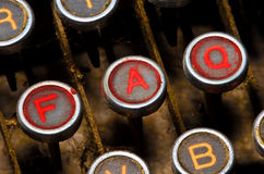Old typewriter and faq keys. Close up of red faq keys royalty free stock photos