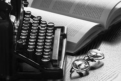 Old Typewriter, Glasses and Book Royalty Free Stock Images