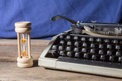 Old typewriter with hourglass Stock Images