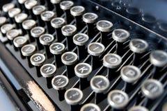 Old typewriter keyboard. Detailed view of an old typewriter's keyboard stock photography