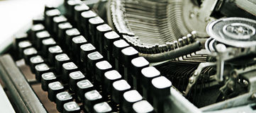 Old typewriter. The keyboard of the old typewriter with details of a printing set and drums of a printing tape Royalty Free Stock Photo