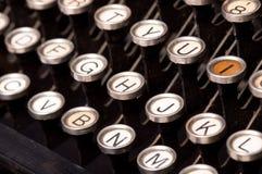 Old typewriter keys. Round keys on a vintage typewriter Stock Photo