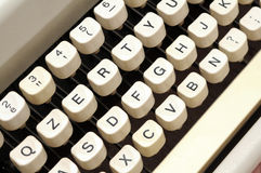 Old typewriter keys. Old typewriter white keys and black letters detail royalty free stock photos
