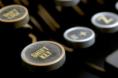 Old Typewriter Keys. With focus on the shift key Royalty Free Stock Photography