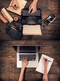 Old typewriter with laptop, concept of old and new Royalty Free Stock Photos