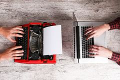 Old typewriter and laptop on table. Concept of technology progress Stock Photos